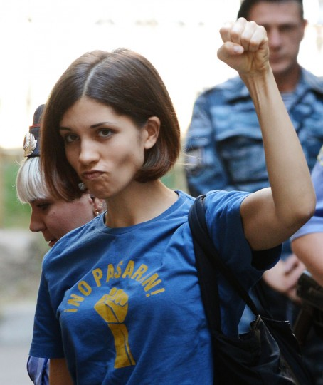 "MOSCOW, RUSSIA - AUGUST 8: Member of female punk band ""Pussy Riot"" Nadezhda Tolokonnikova gestures before a court hearing in Moscow on August 8, 2012. (Natalia Kolesnikova/AFP/Getty Images)"