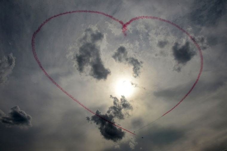 Members of the Red Arrows aerobatic team from the United Kingdom shape a heart with smoke as they perform during the rehearsal of a flight show in Zhukovsky, outside Moscow. (Natalia Kolesnikova/AFP/Getty Images)