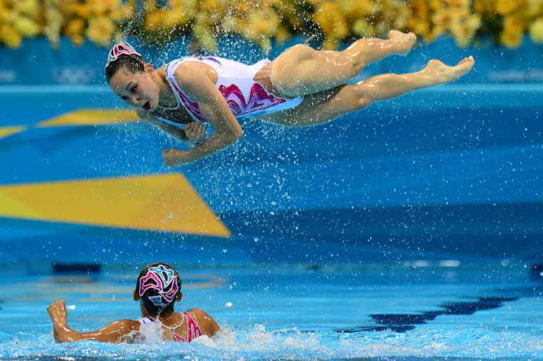 Members of the China's synchronized swimming team compete in the team free routine final during the synchronized swimming competition at the London 2012 Olympic Games in London. (Martin Bureau/AFP/Getty Images)