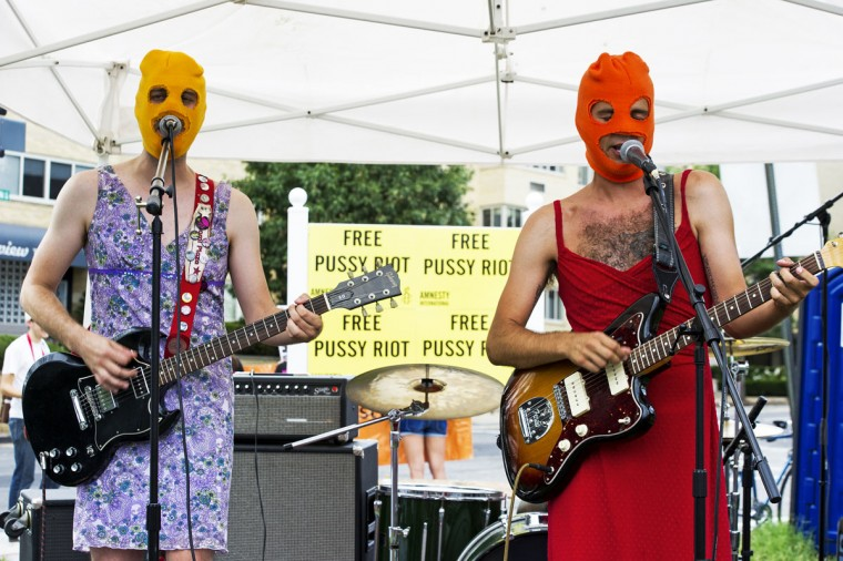"WASHINGTON DC - AUGUST 10: Members of the band ""Brenda"" perform in a dirt lot across the street from the Russian Embassy in Washington on August 10, 2012, in a solidarity concert for the Russian punk rock group Pussy Riot. (Paul J. Richards/AFP/Getty Images)"