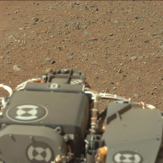 August 9, 2012: A view taken by Mastcam: Left (MAST_LEFT) on board NASA's Mars rover Curiosity on Sol 3 (2012-08-09 05:54:41 UTC) shows the gravelly Martian surface Surrounding Curiosity. (NASA/JPL-Caltech/Malin Space Science Systems/HO/AFP/Getty Images)