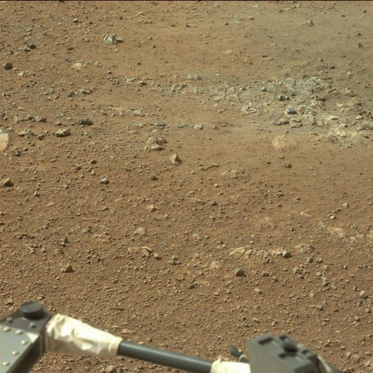 August 9, 2012: A view taken by Mastcam: Left (MAST_LEFT) on board NASA's Mars rover Curiosity on Sol 3 (2012-08-09 05:26:20 UTC) shows the gravelly Martian surface Surrounding Curiosity. (NASA/JPL-Caltech/Malin Space Science Systems/HO/AFP/Getty Images)