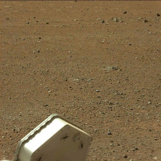 August 9, 2012: A view taken by Mastcam: Left (MAST_LEFT) on board NASA's Mars rover Curiosity on Sol 3 (2012-08-09 05:25:23 UTC) shows the gravelly Martian surface Surrounding Curiosity. (NASA/JPL-Caltech/Malin Space Science Systems/HO/AFP/Getty Images)