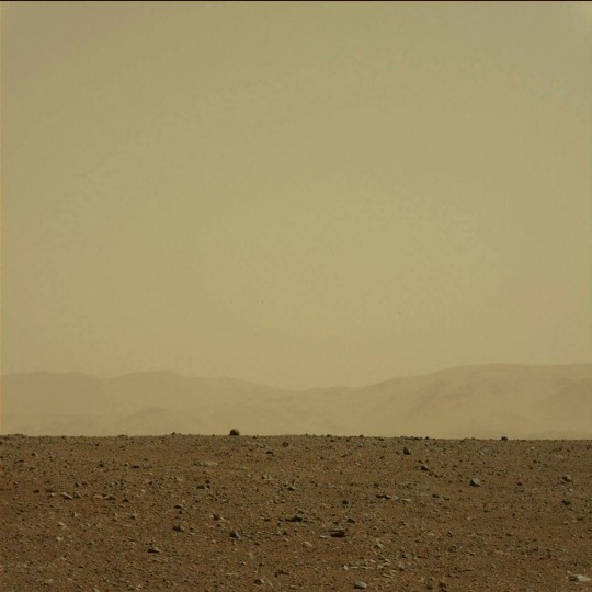 August 9, 2012: A view taken by Mastcam: Left (MAST_LEFT) on board NASA's Mars rover Curiosity on Sol 3 (2012-08-09 05:12:21 UTC) shows the mountains looming in the distance in front of Curiosity. (NASA/JPL-Caltech/Malin Space Science Systems/HO/AFP/Getty Images)