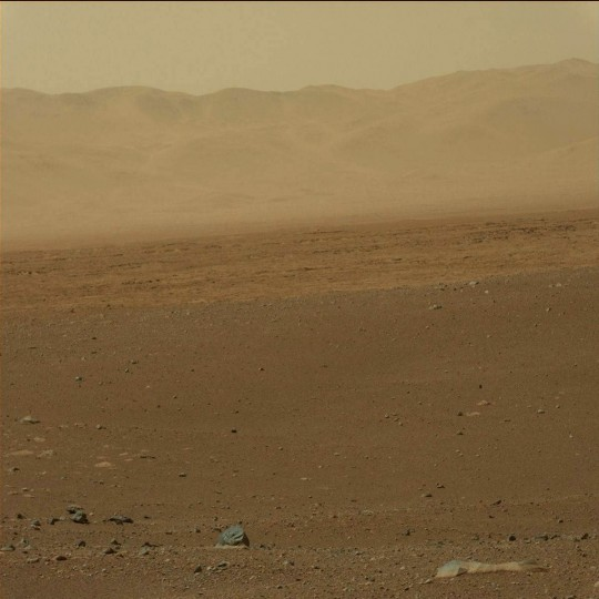 August 9, 2012: A view taken by Mastcam: Left (MAST_LEFT) on board NASA's Mars rover Curiosity on Sol 3 (2012-08-09 05:13:02 UTC) shows the mountains looming in the distance in front of Curiosity. (NASA/JPL-Caltech/Malin Space Science Systems/HO/AFP/Getty Images)