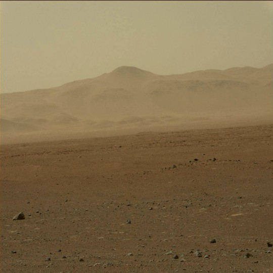 August 9, 2012: A view taken by Mastcam: Left (MAST_LEFT) on board NASA's Mars rover Curiosity on Sol 3 (2012-08-09 05:13:17 UTC) shows the mountains looming in the distance in front of Curiosity. (NASA/JPL-Caltech/Malin Space Science Systems/HO/AFP/Getty Images)