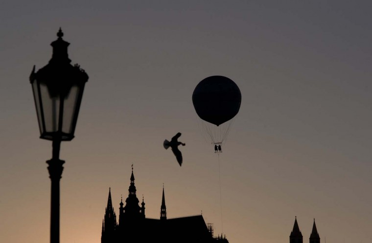 Tourists look at the Prague Castle from a balloon on August 12, 2012 in Prague. (Michal Cizek/AFP/Getty Images)