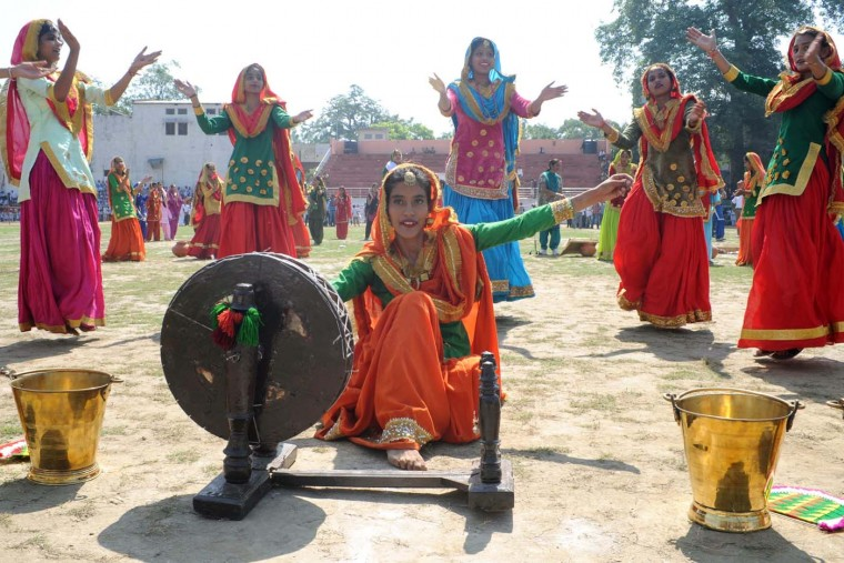 Indian schoolgirls perform the traditional 'giddha' dance during an Independence Day parade rehearsal at The Guru Nanak Stadium in Amritsar on August 13, 2012. India celebrates its 65th independence anniversary from British rule on August 15. (Narinder Nanu/AFP/Getty Images)