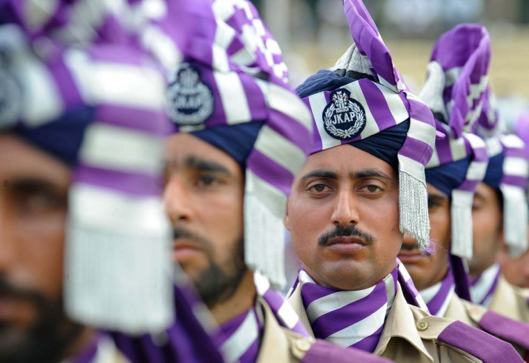 Policemen look on during a full dress rehearsal for India's Independence Day celebrations in Srinagar on August 13, 2012. India will celebrate its 65th Independence Day on August 15. (Rouf Bhat/AFP/Getty Images)