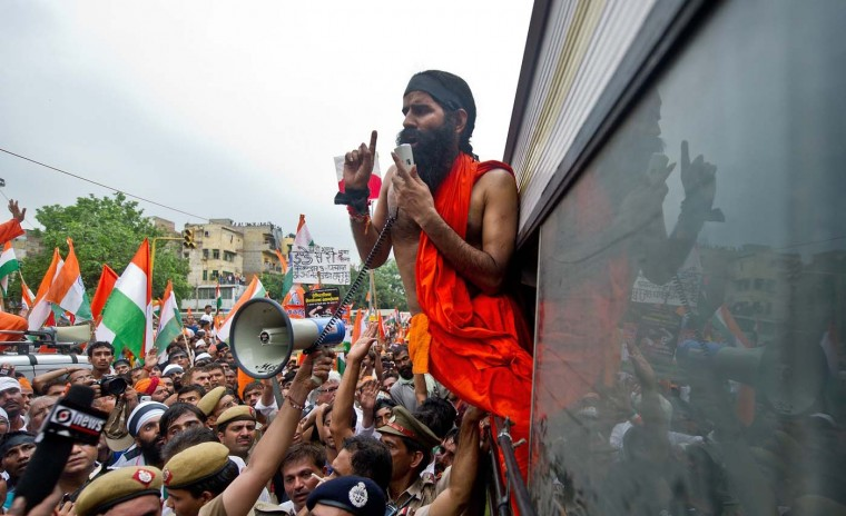 Indian yoga guru Baba Ramdev addresses his supporters after being arrested in New Delhi on August 13, 2012. Indian police arrested the famed TV yoga guru and anti-corruption campaigner Baba Ramdev as he attempted to lead a procession of thousands of supporters to the national parliament. (Prakash Singh/AFP/Getty Images)
