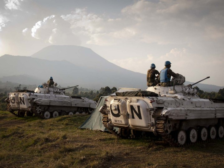 Indian soldiers of the United Nations mission in Democratic Republic of Congo (MONUSCO) sit on the top of tanks at a military post in Kibati, some 10 km from Goma, and some 15 km from the frontline on August 13, 2012. The UN mission in DR Congo, known as MONUSCO, has some 17,000 troops deployed mainly in the east to protect local residents. That part of the country has been at the center of heavy fighting between government forces and the M23 rebels, who broke away from the Congolese army in April to launch an uprising. (Michele Sibiloni/AFP/Getty Images)