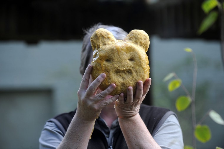 A zookeeper holds a special cake in a shape of a panda for the ninth birthday of Yang Guang (Sunshine), a giant male panda at the Edinburgh Zoo. (Andy Buchanan/AFP/Getty Images)