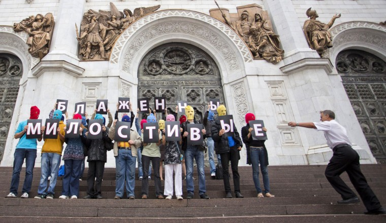 "MOSCOW, RUSSIA - AUGUST 15: Supporters of punk group Pussy Riot, wearing the group's trademark coloured balaclavas, hold individual letters that spell the phrase ""Blessed are the merciful"" outside the Church of Christ the Saviour in central Moscow on August 15, 2012 protesting the incarceration of three band members. (Novaya Gazeta/Yevgeny Feldman/AFP/Getty Images)"
