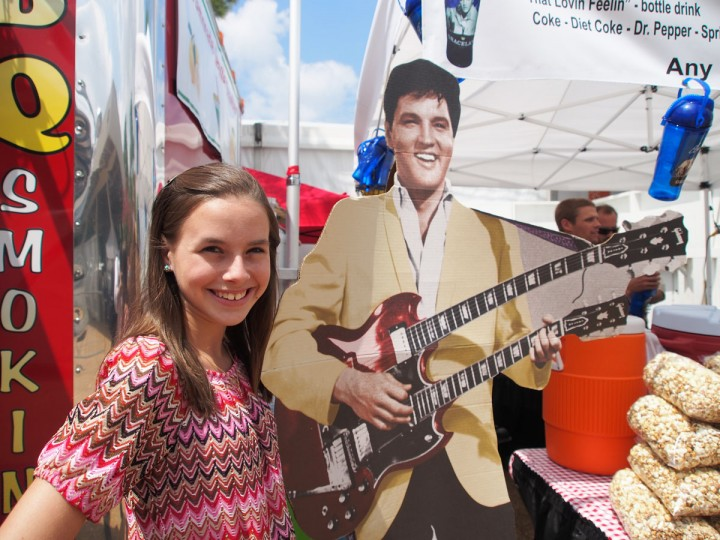 August 14, 2012: Isabella T. Scott, 13, from Bonifay, Florida poses in front of a cut-out of Elvis Presley on during Elvis Week at Graceland in Memphis, Tennessee. Scott, president of the online Elvis Aaron Presley-TCB 4EVR Official Fan Club, is the youngest president of any officially recognized Elvis Presley fan club in the world. (Robert MacPherson/AFP/Getty Images)