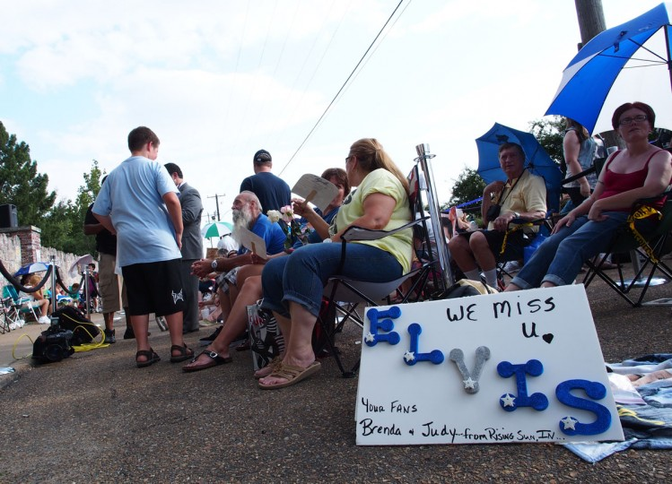 August 15, 2012: Fans of Elvis Presley gather outside Graceland mansion, home of the late King of Rock 'n' Roll, on the eve of the 35th anniversary of his death. (Robert MacPherson/AFP/Getty Images)