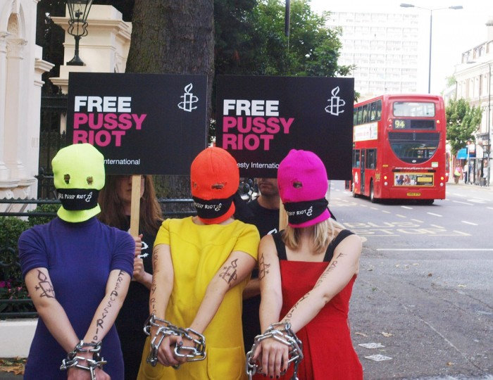 LONDON, ENGLAND - AUGUST 12: Three Amnesty International activists dressed as the Russian Band Pussy Rioters outside the Russian Embassy in London on August 12, 2012 protest for the release of three band members, who face three years in prison for staging a protest stunt against President Vladimir Putin inside a landmark Moscow church. (Max Nash/AFP/Getty Images)