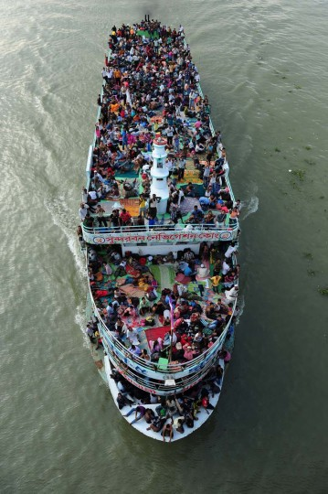 Thousands of Bangladeshis cram ferries, as they rush home to be with their families in remote villages before the Muslim Eid festival, at Sadarghat ferry terminal on the outskirts of Dhaka. (Munir uz Zaman/Getty Images)