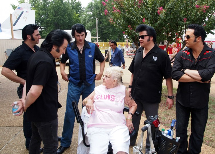 August 14, 2012: Elvis Presley tribute artists gather around Elvis fan Yvonne Robertson of Windsor, Ontario, Canada during Elvis Week at Graceland in Memphis, Tennessee. This year's Elvis Week marks the 35th anniversary of the death of the King of Rock and Roll. (Robert MacPherson/AFP/Getty Images)