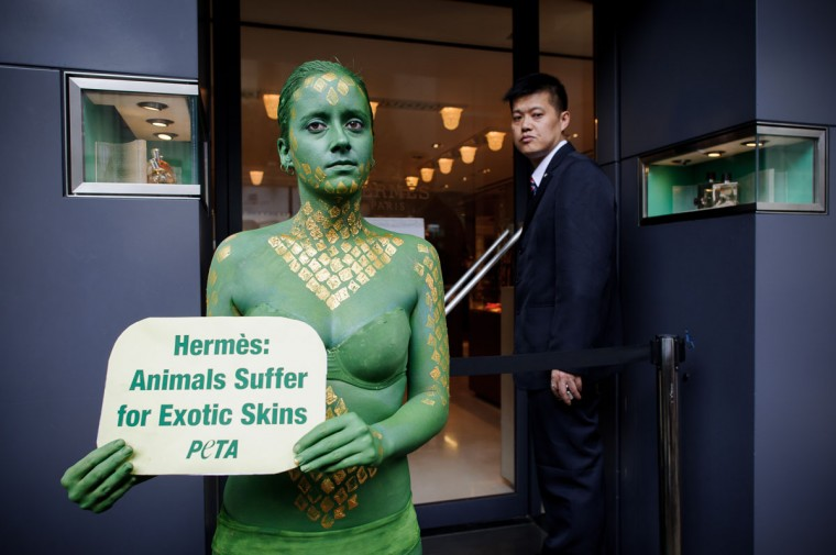 An activist of the People for the Ethical Treatment of Animals (PETA) pose outside a shop of French luxury brand Hermes in Hong Kong. PETA called on the company to end the sale of exotic-animal skins, raising awareness among tourists and shoppers about exotic animals being skinned alive, beaten to death and killed for their skin in other cruel ways. (Philippe Lopez/AFP/Getty Images)
