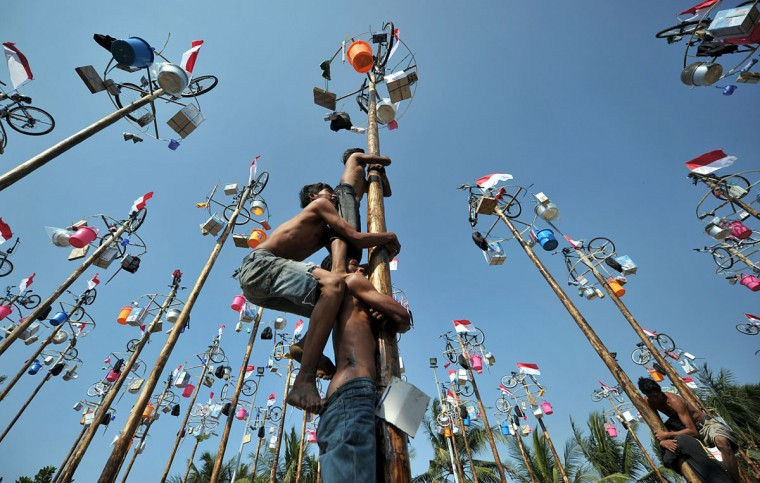 People attempt to climb greased and slippery poles, to which prizes and flags are attached, to celebrate Indonesia's Independence Day in Jakarta. Indonesia marked the 67th anniversary of its freedom from Dutch rule on August 17. (Bay Ismoyo/AFP/Getty Images)