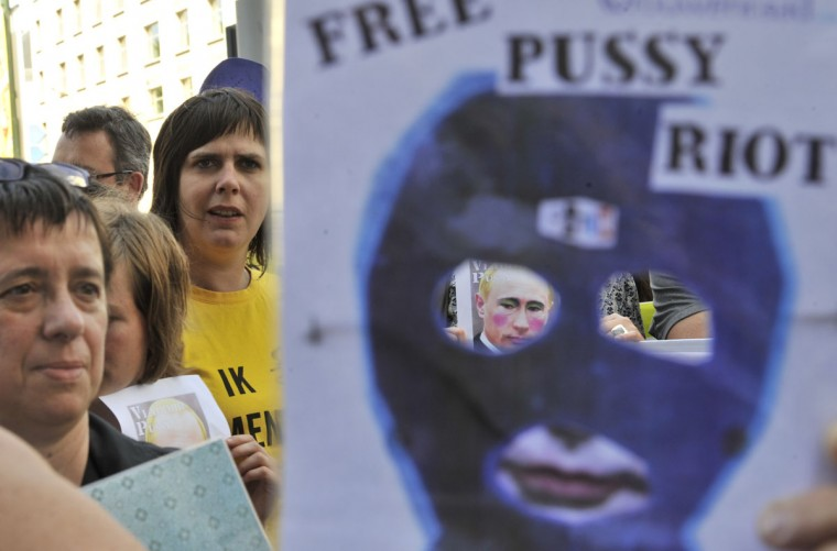 BRUSSELS, BELGIUM - AUGUST 17: Amnesty International activists protest close to the Russian Embassy in Brussels on August 17, 2012, for the release of three Pussy Riot band members, who face three years in prison for staging a protest stunt against President Vladimir Putin inside a landmark Moscow church. (Georges Gobet/AFP/Getty Images)