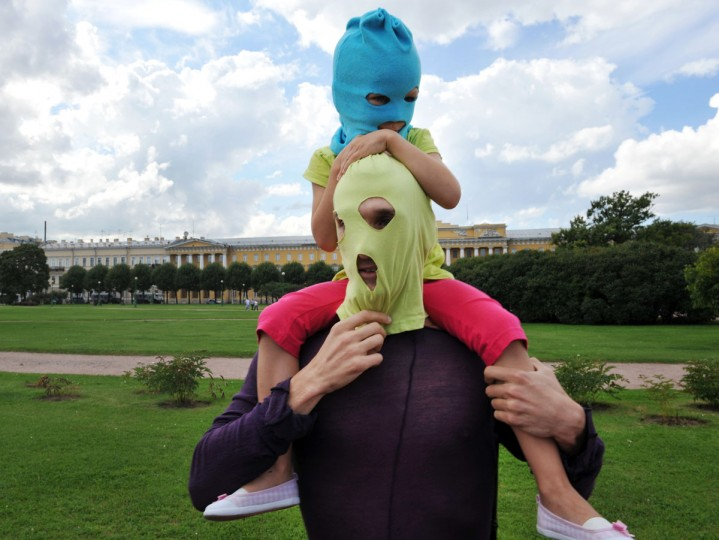 "ST. PETERSBURG, RUSSIA - AUGUST 17: A father and his daughter, supporters of feminist punk band ""Pussy Riot"", wear the group's trademark coloured balaclava in St. Petersburg on August 17, 2012. (Olga Maltsevaolga/AFP/Getty Images)"