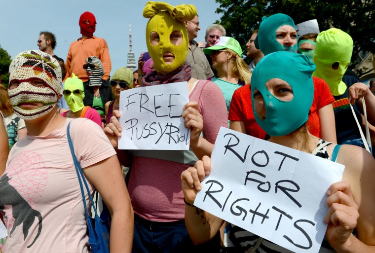 "HAMBURG, GERMANY - AUGUST 17: Supporters of Russian band ""Pussy Riot"" participate in a demonstration of solidarity on August 17, 2012 in Hamburg, northern Germany. (Marcus Brandt/AFP/Getty Images)"