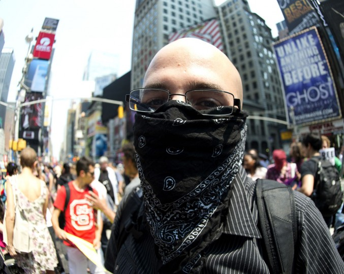 NEW YORK CITY - AUGUST 17: A man rallies in Times Square in support of the group Pussy Riot wearing a bandana on his face August 17, 2012 in New York. (Don Emmert/AFP/Getty Images)