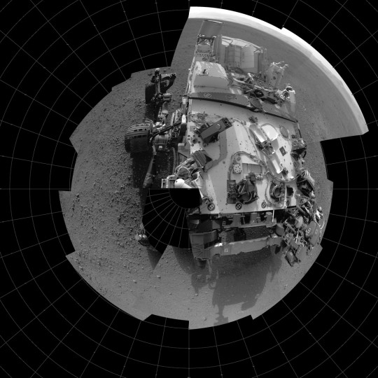 August 17, 2012: A self-portrait showing the deck of NASA's Curiosity rover from the rover's Navigation camera. The full-resolution images, taken from 360 degrees around the rover, are displayed here as a polar projection. The rim of Gale Crater can be seen at upper right. This mosaic is made of 20 images taken late at night on Aug. 7 PDT (early morning Aug. 8 EDT). (NASA/JPL-Caltech/HO/AFP/Getty Images)