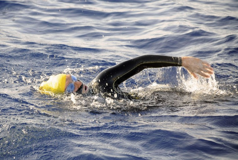 US endurance swimmer Diana Nyad swims in the Florida Straits between Cuba and the Florida Keys on August 19, 2012. Nyad abandoned her fourth attempt to swim from Cuba to Florida on August 21, after battling storms and jellyfish for more than two days, according to her crew. The 62-year-old hit the water on Saturday at the start of the 103-mile (166-kilometer) swim across the Florida Straits, a trek she attempted without a protective shark cage. (Christi Barli/Diana Nyad via the Florida Keys News Bureau/Barli/AFP/Getty Images)