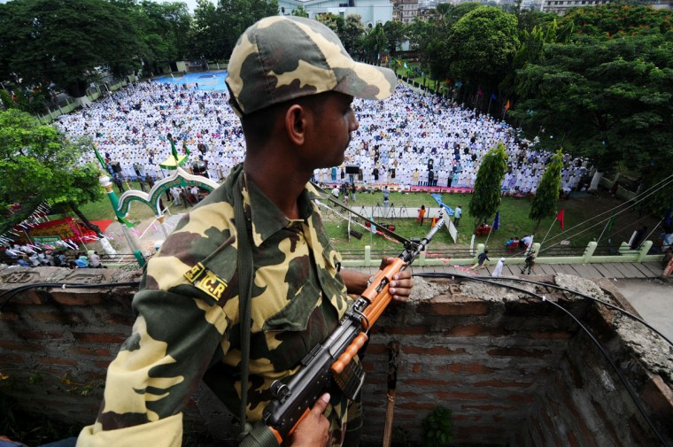 An Indian Central Reserve Police Force (CRPF) member stands guard on a building during Eid al-Fitr prayers at the Eidga field in Guwahati, the capital city of the northeastern state of Assam on August 20, 2012. (AFP/Getty Images)
