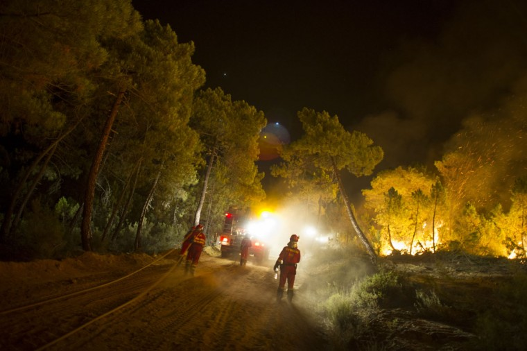 Firefighters work at the site of a wildfire in Torneros de Jamuz near Leon on August 20, 2012. Numerous wildfires have broken out across Spain in the sweltering heat in recent weeks, an extra headache for authorities struggling to get the country out of its financial crisis and recession. (Pedro Armestre/AFP/Getty Images)