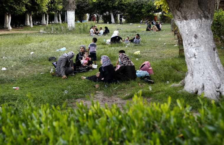 Palestinian families picnic at a park on the second day of Eid al-Fitr, marking the end of Islam's fasting holy month of Ramadan, in Gaza City on August 20, 2012. (Mohammed Abed/AFP/Getty Images)