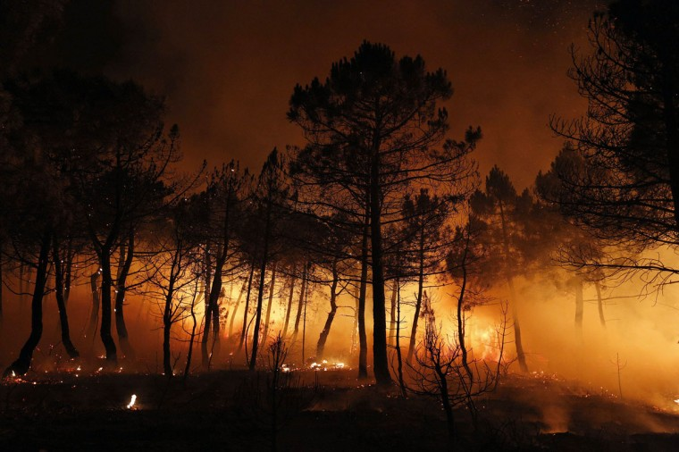 Embers from a wildfire glow on the ground in Tabuyo del Monte, near Leon. (Cesar Manso/AFP/Getty Images)