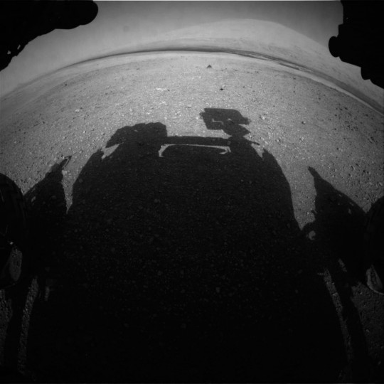 This image released by NASA shows an image Front Hazcam: Left A (FHAZ_LEFT_A) onboard NASA's Mars rover Curiosity on Sol 15, August 21, 2012 at 14:21:30 UTC. (NASA/JPL-Caltech via Getty Images)