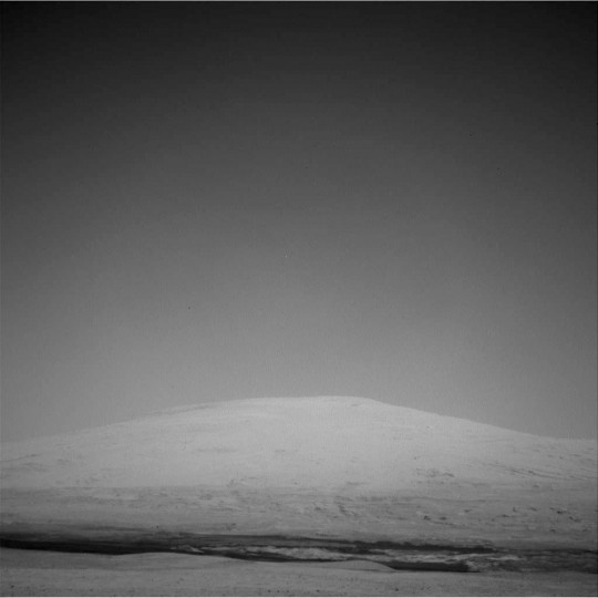 This image released by NASA shows Mount Sharp taken by Navcam: Left A (NAV_LEFT_A) on board NASA's Mars rover Curiosity on Sol 15, August 21, 2012 at 13:42:26 UTC. (NASA/JPL-Caltech via Getty Images)