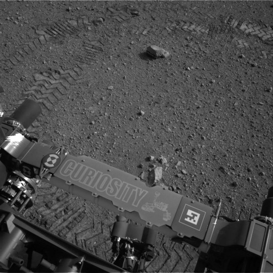 This image released by NASA shows tracks made by Curiosity's tires during its first test drive as seen by Navcam: Left A (NAV_LEFT_A) on board NASA's Mars rover Curiosity on Sol 16, August 22, 2012 at 15:16:35 UTC. (NASA/JPL-Caltech via Getty Images)