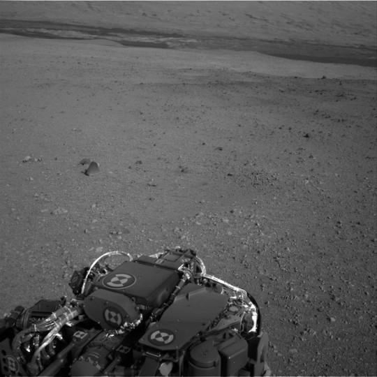 This image released by NASA shows terrain around the Curiosity rover during its first test drive as seen by Navcam: Right A (NAV_RIGHT_A) on board NASA's Mars Curiosity rover on Sol 16, August 22, 2012 at 15:09:56 UTC. (NASA/JPL-Caltech via Getty Images)