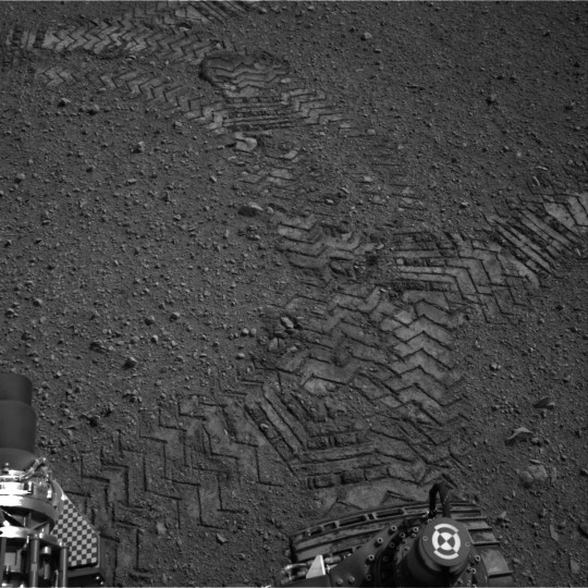 This image released by NASA shows tracks made by Curiosity's tires during its first test drive as seen by Navcam: Right A (NAV_RIGHT_A) on board NASA's Mars rover Curiosity on Sol 16, August 22, 2012 at 15:03:56 UTC. (NASA/JPL-Caltech via Getty Images)