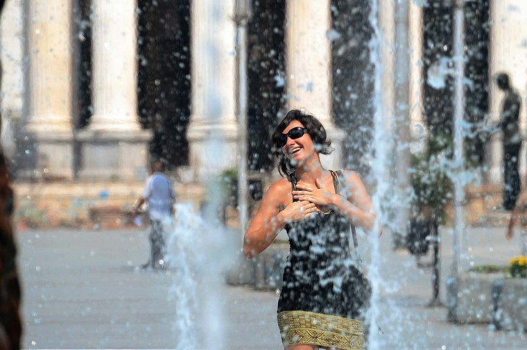 A woman refreshes herself in a fountain in the centre of Skopje. Macedonia is hit by another heat wave as temperatures are over 40 degrees Celsius. (Robert Atanasovski/Getty Images)