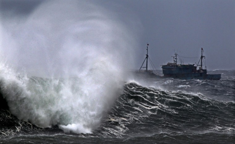 A Chinese fishing boat fights high waves after taking shelter in a port on the southern island of Jeju on August 27, 2012, ahead of the arrival of a major typhoon. Officials were put on high alert with classes cancelled in Seoul and other cities as Typhoon Bolaven -- one of the most powerful storms in the region in decades -- was churning towards the peninsula. (Yon Hap/AFP/Getty Images)