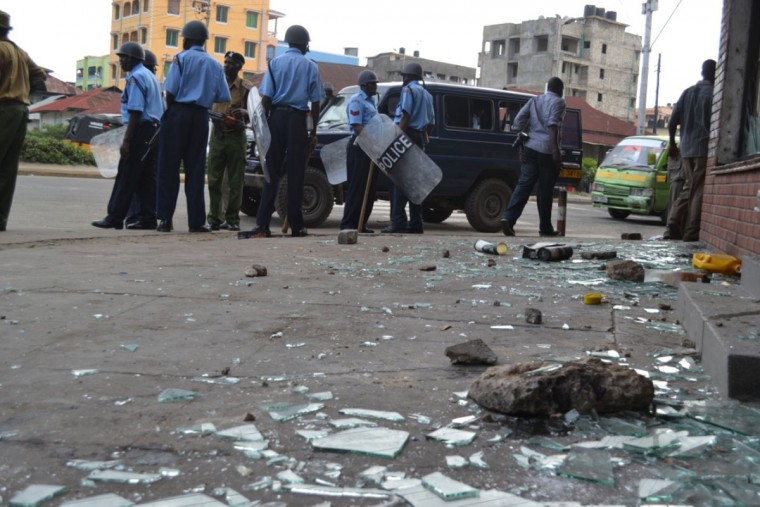 Kenyan police patrol the port city of Mombasa on August 27, 2012 after riots occurred following the killing of a radical cleric linked to Somalia's Al-Qaeda allied Shebab, Aboud Rogo Mohammed. One person was killed and two churches were looted in Mombasa on August 27, after the killing of the cleric. (Stringer/AFP/Getty Images)