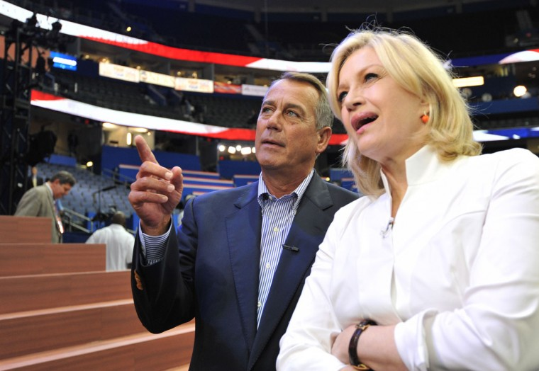 The speaker of the United States House of Representatives John Boehner and ABC News anchor Diane Sawyer look at the stage at the Tampa Bay Times Forum in Tampa, Florida, during final preparations for the opening of the Republican National Convention on August 27, 2012. (Stan Honda/AFP/Getty Images)