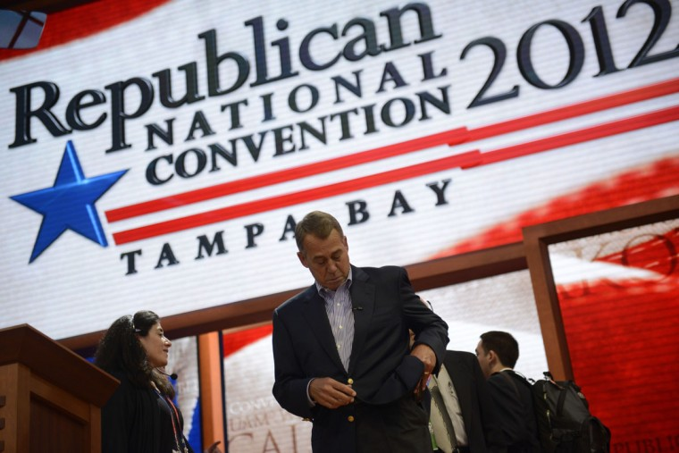 The speaker of the United States House of Representatives John Boehner checks his pockets on stage at the Tampa Bay Times Forum in Tampa, Florida, during final preparations for the opening of the Republican National Convention on August 27, 2012. (Brendan Smialowski/AFP/Getty Images)