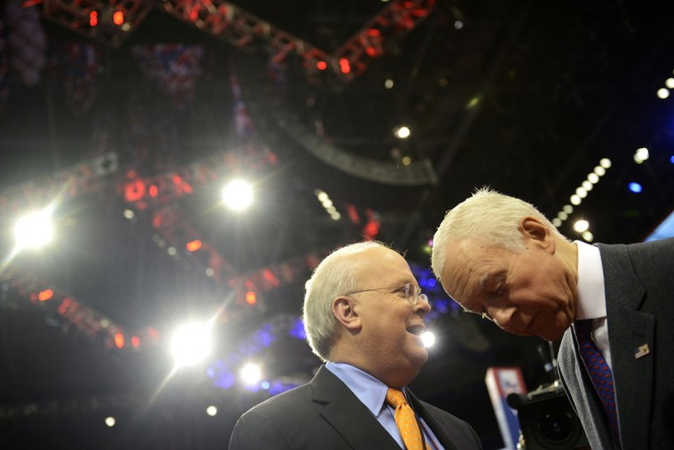 American political consultant Karl Rove (L) and Senator Orrin Hatch from Utah (R) share a word at the Tampa Bay Times Forum in Tampa, Florida, during final preparations for the opening of the Republican National Convention on August 27, 2012. (Brendan Smialowski/AFP/Getty Images)