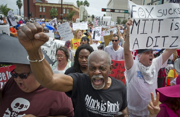Anti-GOP protesters shout slogans during a protest march at the streets of Tampa on August 27, 2012. Some 200 protesters braved inclement weather Monday to protest Republican policies at the party convention. (Mladen Antonov/AFP/Getty Images)