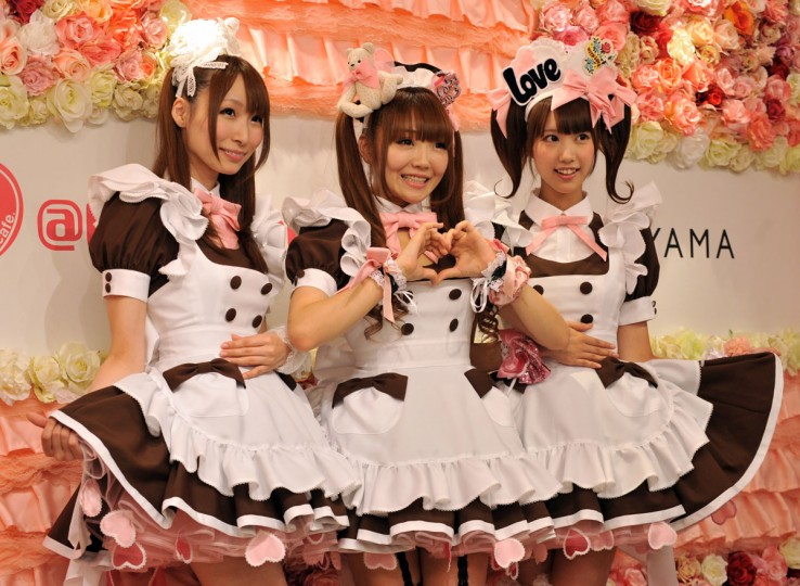 "Waitresses (L-R) Minami, Hitomi and Kiki, display their new uniforms at the maid cafe ""@home cafe"" in Tokyo's Akihabra, a mecca for maid cafes. Japanese designer Keita Maruyama designed the new uniforms for the maid cafe, which is a popular icon of Japanese subculture. (Yoshikazu Tsuno/AFP/Getty Images)"