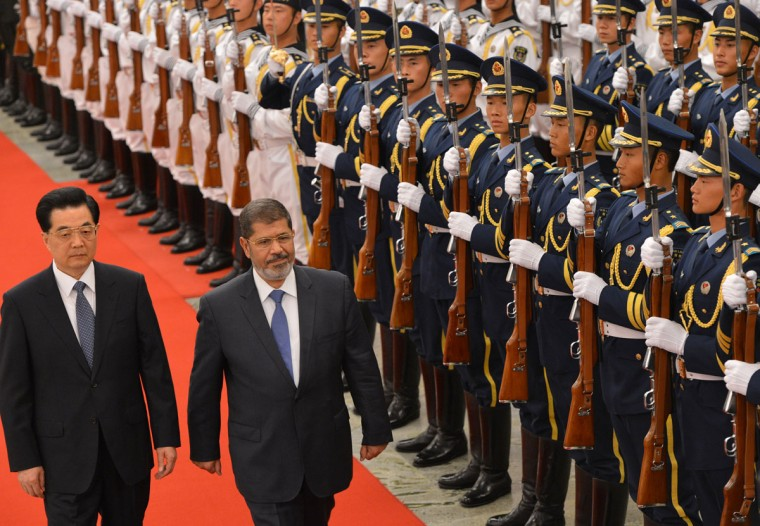 Chinese President Hu Jintao (L) and Egyptian President Mohamed Morsi (2nd L) review an honor guard during a welcoming ceremony at the Great Hall of the People in Beijing. Egypt's president met his Chinese counterpart in Beijing seeking in his first state visit outside the Arab world to win badly needed investment and expand diplomatic ties. (Mark Ralston/AFP/Getty Images)