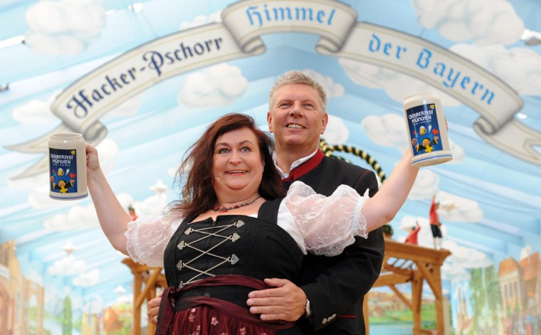 Cabaret artist Lizzy Aumeier and new Oktoberfest director Dieter Reiter present the official 2012 Oktoberfest beer mugs in Munich, southern Germany. This year's Oktoberfest will take place from September 22 to October 07, 2012. (Tobias Hase/AFP/Getty Images)