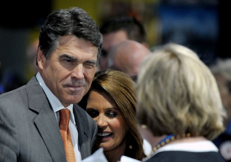 """Former Republican party presidential candidate Governor Rick Perry jokes with an activist during a pro-life event called """"Treasure Life"""" at the Tampa Aquarium in Tampa, Florida on August 28, 2012. The Republican National Coalition for Life and FRC Action's event, """"Treasure Life,"""" honored the pro-life contributions of the former Republican party presidential candidates Sen. Rick Santorum, Rep. Michele Bachmann and Gov. Rick Perry for their advocacy for every stage of life, from conception to natural death. (Mladen Antonov/AFP/Getty Images)"""